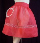 A 50's apron like this one can be found at Alameda Point (Sold online at Heavenly Lingerie)