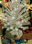 Tinsel tree & toy train by Jara Ra