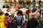 Shoppers with wine barrels as a backdrop